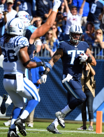Oct 23 2016 Nashville TN USA Tennessee Titans Offensive Tackle Taylor Lewan 77 Runs For A Touchdown After Reception During The First Half Against